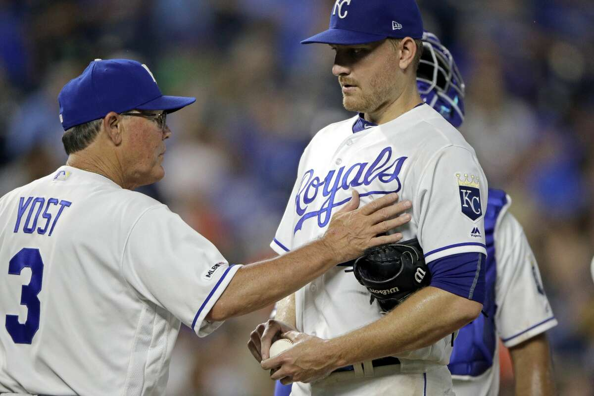Kansas City Royals manager Ned Yost talks to starting pitcher Mike Montgomery before pulling him from the baseball game against the Housotn Astros during the sixth inning Saturday, Sept. 14, 2019, in Kansas City, Mo. (AP Photo/Charlie Riedel)