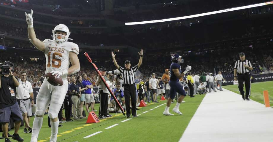 Texas Longhorns wide receiver Jake Smith (16) celebrates his second quarter touchdown against Rice University at NRG Stadium in Houston on Saturday, Sept. 14, 2019. Photo: Elizabeth Conley/Staff Photographer