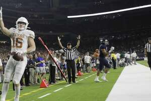 Texas Longhorns wide receiver Jake Smith (16) celebrates his second quarter touchdown against Rice University at NRG Stadium in Houston on Saturday, Sept. 14, 2019.