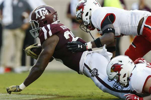 Texas A&M Aggies running back Jacob Kibodi (23) scores a two-yard touchdown against the Lamar Cardinals during the first quarter of an NCAA game at Kyle Field Saturday, Sept. 14, 2019, in College Station, Texas.