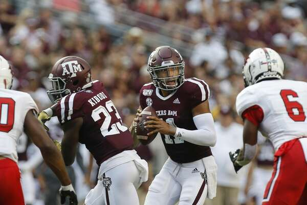 Texas A&M Aggies quarterback Kellen Mond (11) looks for an open receiver against the Lamar Cardinals during the first quarter of an NCAA game at Kyle Field Saturday, Sept. 14, 2019, in College Station, Texas.
