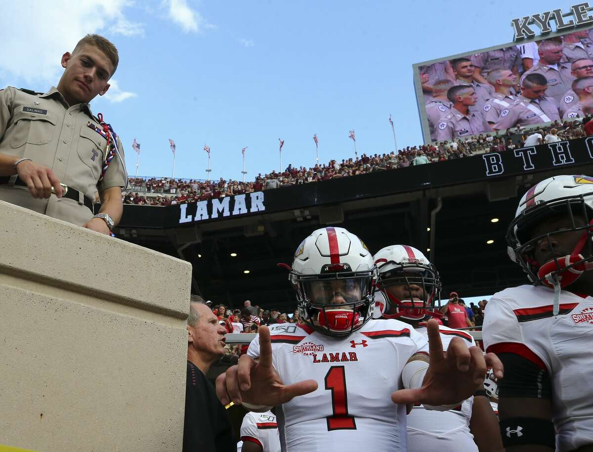 Lamar Cardinals quarterback Jordan Hoy (1) acknowledges the camera as players wait to take the field before the start of an NCAA game against the Texas A&M Aggies at Kyle Field Saturday, Sept. 14, 2019, in College Station, Texas.
