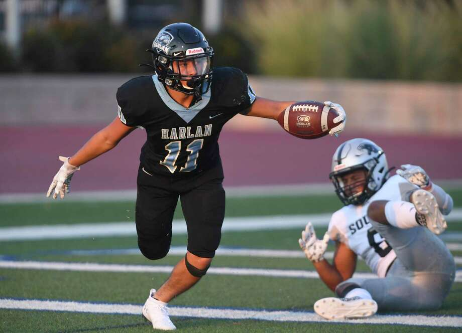 Harlan's Ethan Esparza scores a first-half touchdown against Laredo United South defender Zion Martinez during high school football action at Farris Stadium on Saturday, Sept. 14, 2019. Photo: Billy Calzada, Staff / Staff Photographer / San Antonio Express-News