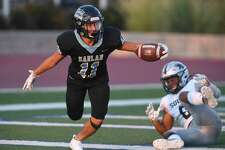 Harlan's Ethan Esparza scores a first-half touchdown against Laredo United South defender Zion Martinez during high school football action at Farris Stadium on Saturday, Sept. 14, 2019.