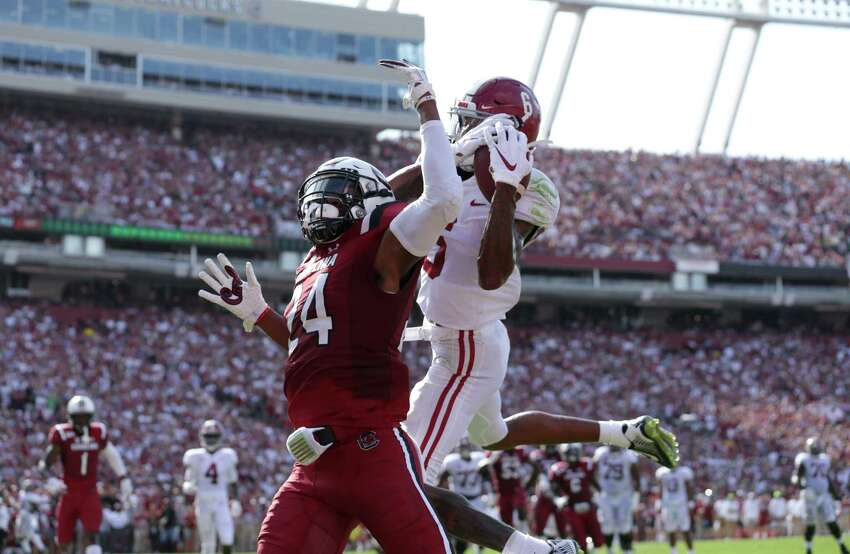 COLUMBIA, SOUTH CAROLINA - SEPTEMBER 14: DeVonta Smith #6 of the Alabama Crimson Tide catches a touchdown over Israel Mukuamu #24 of the South Carolina Gamecocks during their game at Williams-Brice Stadium on September 14, 2019 in Columbia, South Carolina. (Photo by Streeter Lecka/Getty Images)