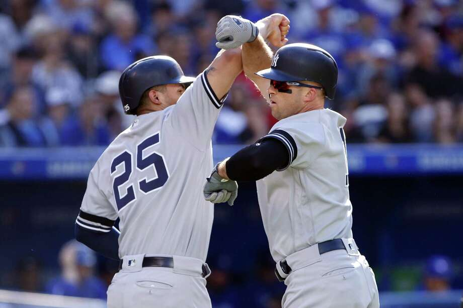 TORONTO, ON - SEPTEMBER 14: Brett Gardner #11 of the New York Yankees celebrates a three run home run with Gleyber Torres #25 at home plate during the fifth inning of their MLB game against the Toronto Blue Jays at Rogers Centre on September 14, 2019 in Toronto, Canada. (Photo by Cole Burston/Getty Images) Photo: Cole Burston / 2019 Getty Images