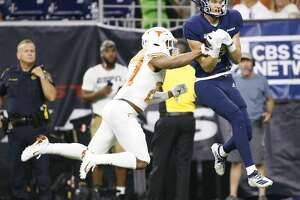 Rice Owls wide receiver Brad Rozner (2) catches the ball against Texas Longhorns defensive back Donovan Duvernay (27)  at NRG Stadium in Houston on Saturday, Sept. 14, 2019. Texas Longhorns won the game 48-13.