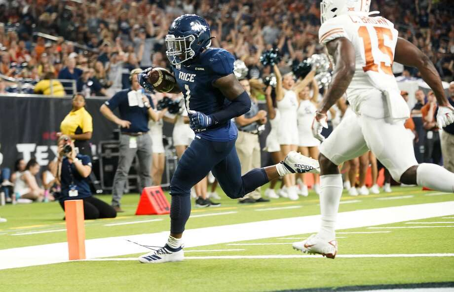 Rice Owls running back Aston Walter (1) runs the ball in for a touchdown against  University of Texas at NRG Stadium in Houston on Saturday, Sept. 14, 2019. Texas Longhorns won the game 48-13. Photo: Elizabeth Conley/Staff Photographer