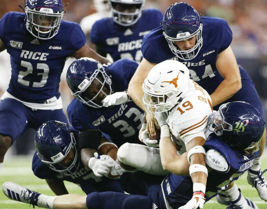 PHOTOS: Rice vs. Texas  Texas Longhorns wide receiver Kartik Akkihal (19) is taken down by Rice Owls defense in the second half of game action at NRG Stadium in Houston on Saturday, Sept. 14, 2019. Texas Longhorns won the game 48-13. >>>See more photos from the Owls' game against the Longhorns last week ...  Photo: Elizabeth Conley/Staff Photographer