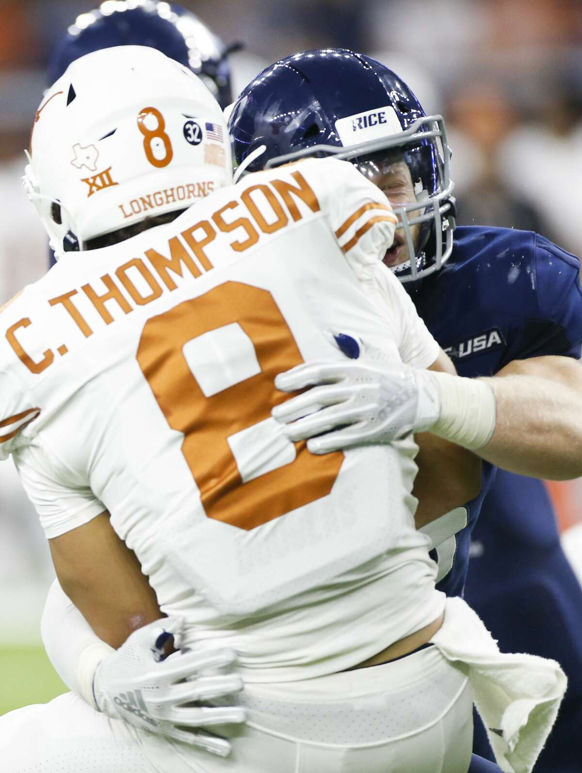 Texas Longhorns quarterback Casey Thompson (8) is sacked by Rice Owls linebacker Blaze Alldredge (55) at NRG Stadium in Houston on Saturday, Sept. 14, 2019. Texas Longhorns won the game 48-13.