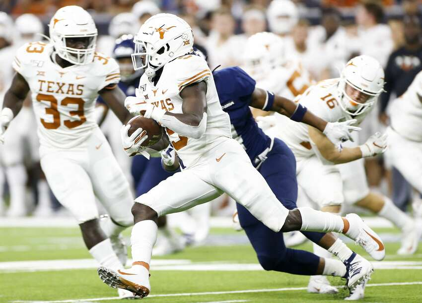 Texas Longhorns defensive back D'Shawn Jamison (5) runs a kickoff for a touchdown in the fourth quarter against Rice University at NRG Stadium in Houston on Saturday, Sept. 14, 2019. Texas Longhorns won the game 48-13.