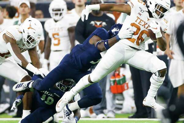 Texas running back Keaontay Ingram takes a long stride to make the first down in the second quarter against Rice at NRG Stadium on Saturday night.