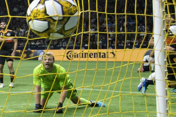 Houston Dynamo goalkeeper Joe Willis watches the ball strike the back of the net after Vancouver Whitecaps' Fredy Montero, back right, scored during the second half of an MLS soccer game in Vancouver, on Saturday Sept. 14, 2019. (Darryl Dyck/The Canadian Press via AP)