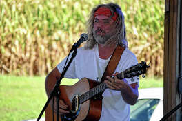 Lenny from Lenny and Molly performs Saturday during the Scott County Farm Aid concerts at Plum Creek Golf Course. Proceeds raised by the concerts will go to Scott County farmers that were impacted by the flooding this season. The concerts will continue from 1-8 p.m. today. Tickets are $15.