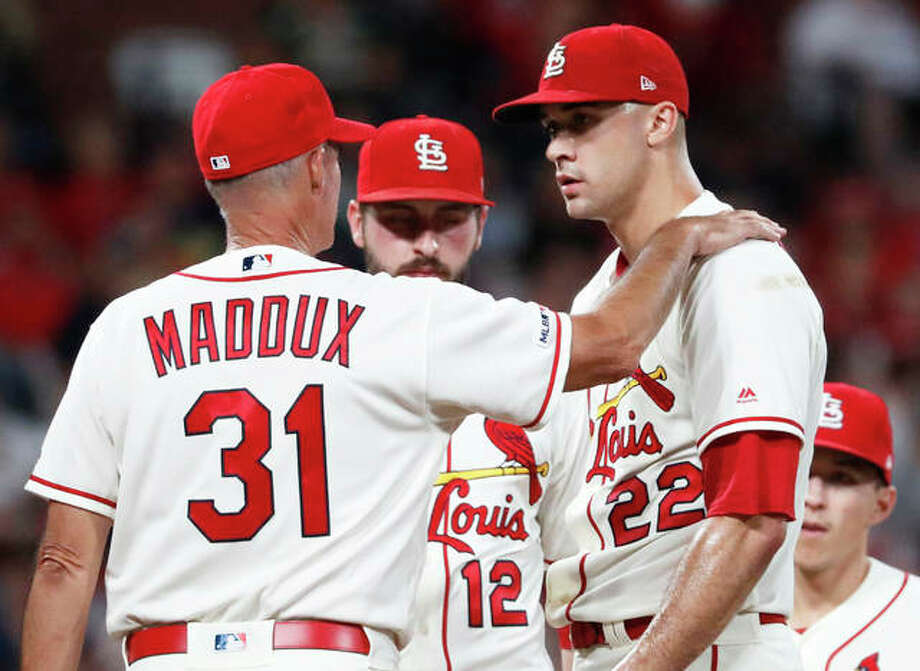 Cardinals pitching coach Mike Maddux talks with starting pitcher Jack Flaherty (22) as shortstop Paul DeJong (12) listens during the sixth inning against the Milwaukee Brewers on Saturday night in St. Louis. Photo: Associated Press