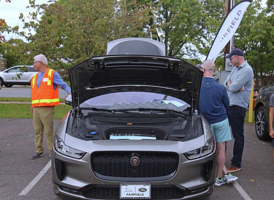 Osborn Hill Elementary School principal David Hudspeth, at right, looks over a car at the Green Wheel Expo on Saturday, Sept. 14, 2019, at the Mill Plain Lot in Fairfield, Conn. Photo: Jarret Liotta / Jarret Liotta / ©Jarret Liotta