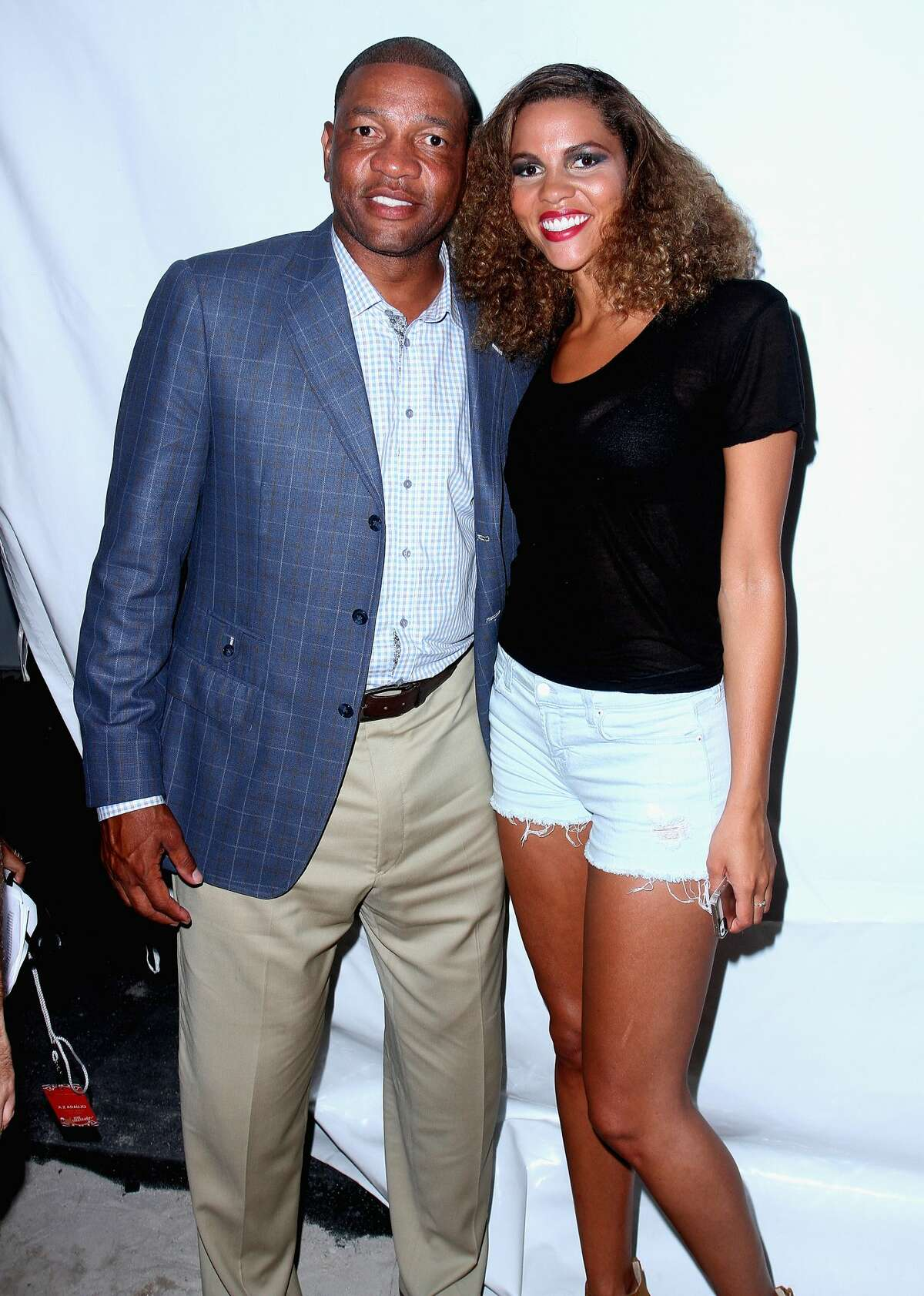 Doc Rivers and daughter Callie Rivers attend the A.Z Araujo show during Mercedes-Benz Fashion Week Swim 2015 The Raleigh on July 21, 2014 in Miami Beach, Florida.