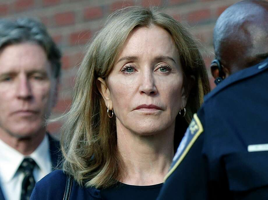 Felicity Huffman leaves federal court with her brother Moore Huffman Jr. following, after she was sentenced in a nationwide college admissions bribery scandal, Friday, Sept. 13, 2019, in Boston. (AP Photo/Michael Dwyer) Photo: Michael Dwyer / Associated Press / Copyright 2019 The Associated Press. All rights reserved
