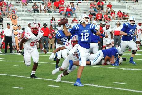 Clear Springs' Garrett Rooker (12) threw three touchdown passes against George Ranch on Friday.