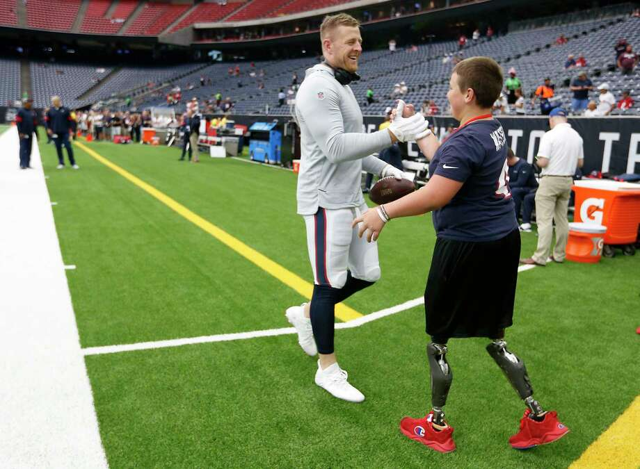 PHOTOS: Calder Hodge on the Texans sidelines and at training camp Houston Texans defensive end J.J. Watt greets Calder Hodge as he plays catch with fans before an NFL football game against the Jacksonville Jaguars at NRG Stadium on Sunday, Sept. 15, 2019, in Houston. Browse through the photos above for a look at Calder Hodge at the Texans game and at training camp ... Photo: Brett Coomer, Staff Photographer / © 2019 Houston Chronicle