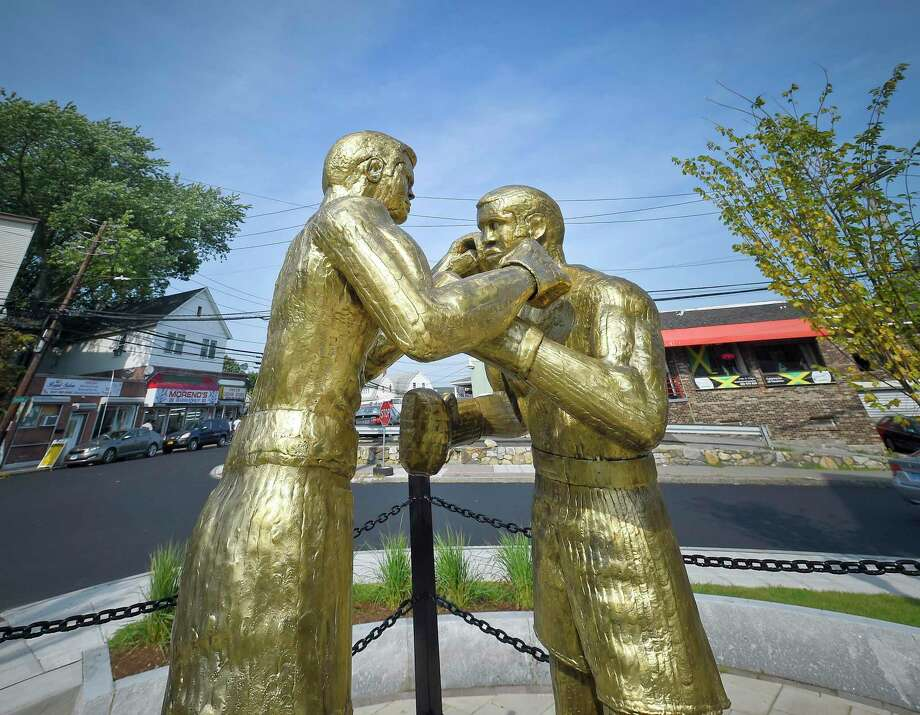 Bronze sculptures honoring boxing legends Muhammad Ali and Joe Frazier are now on display at the revamped Boxer Square at the intersection of Smith Street and Stillwater Avenue in Stamford. Photo: Matthew Brown / Hearst Connecticut Media / Stamford Advocate