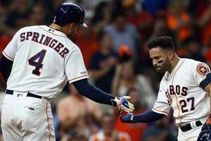 HOUSTON, TEXAS - SEPTEMBER 09: Jose Altuve #27 of the Houston Astros is congratulated by George Springer #4 after hitting a home run in the second inning against the Oakland Athletics at Minute Maid Park on September 09, 2019 in Houston, Texas. (Photo by Bob Levey/Getty Images)