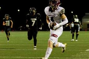 Magnolia West wide receiver Payton Finch (4) catches a 38-yard touchdown pass from quarterback Tristan Brady during the third quarter of a non-district high school football game at Guy K. Traylor Stadium, Saturday, Sept. 14, 2019, in Rosenberg.