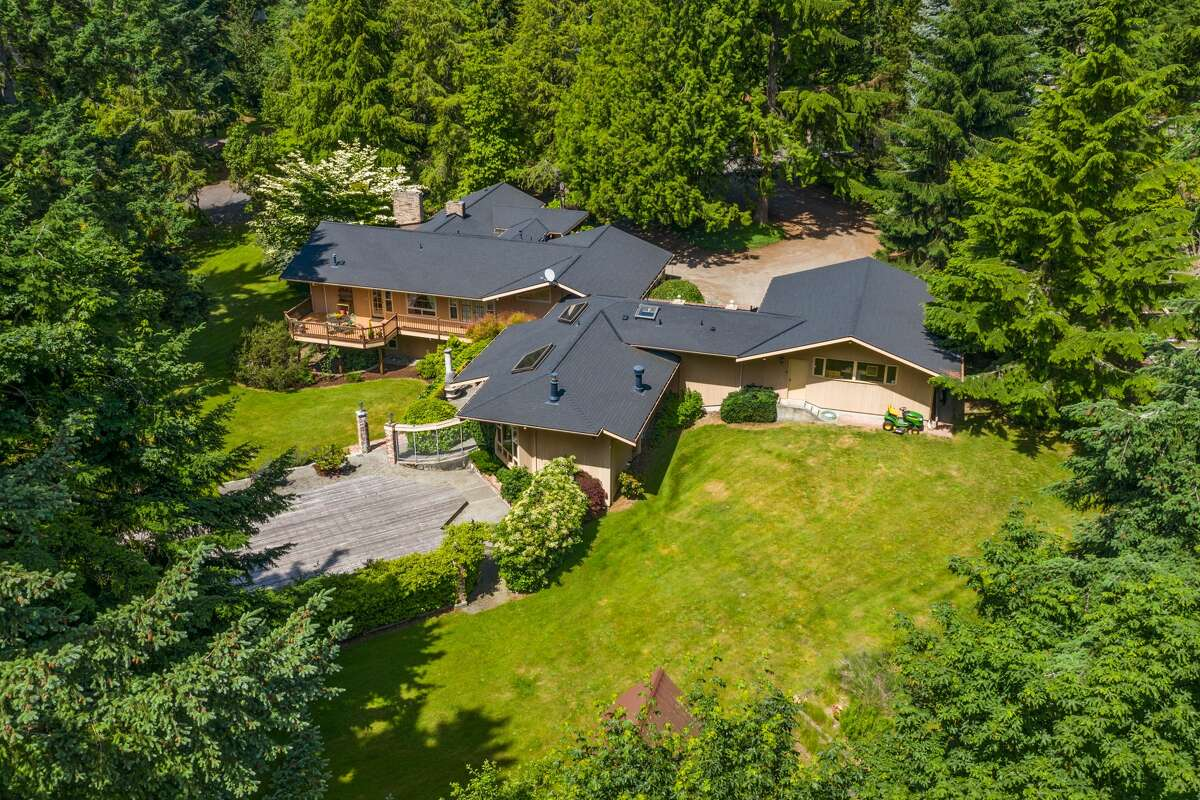 On over 2 acres, a $2M custom estate in Kirkland awaits a new owner after 50+ years with one family.
