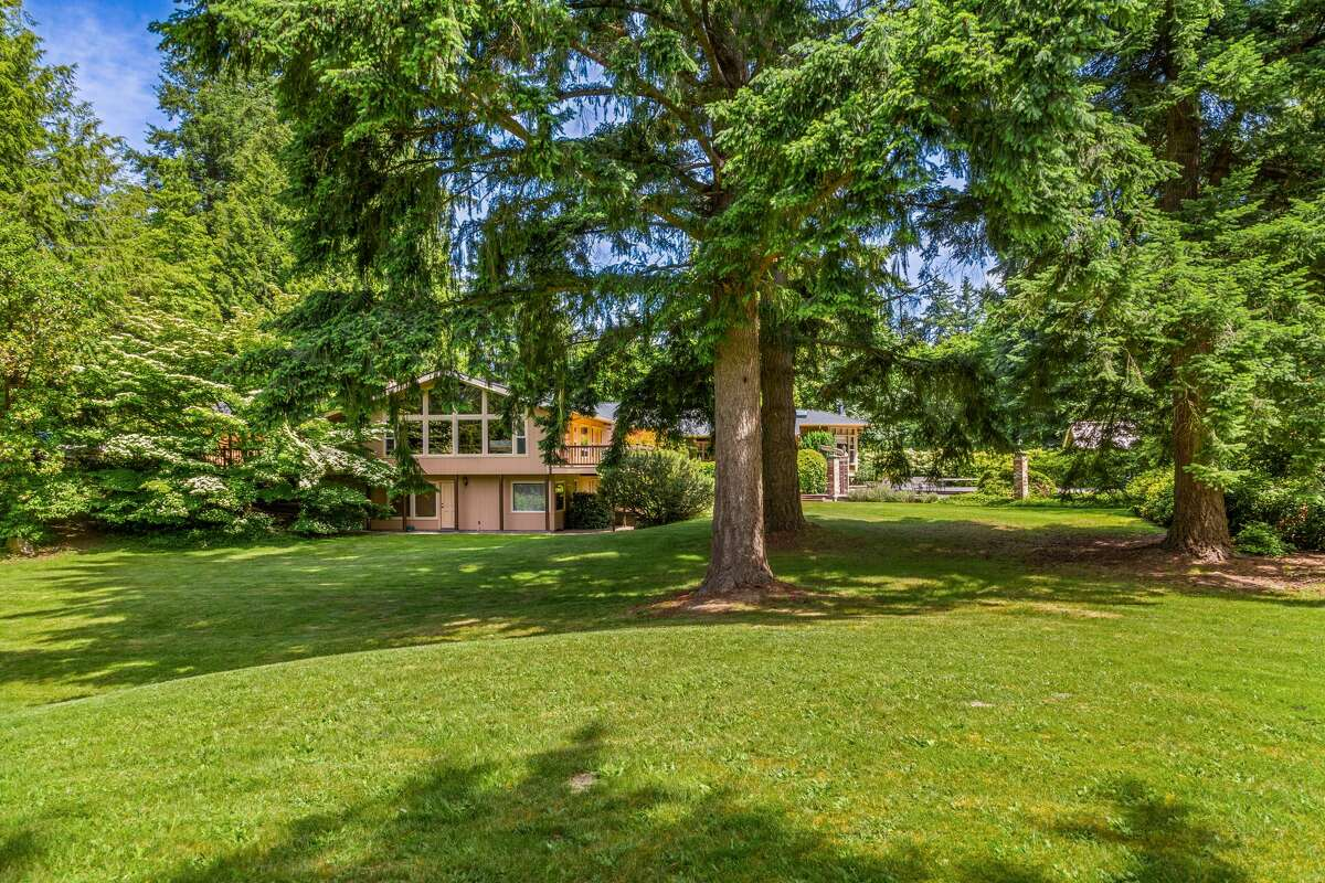 On 2 acres in Kirkland, this $2M estate-like abode seeks new owners for the first time in over 50 years.