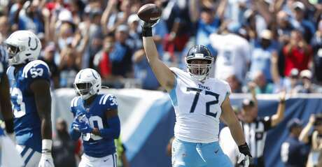 Tennessee Titans' David Quessenberry (72) celebrates after catching a touchdown pass against the Indianapolis Colts in the first half of an NFL football game Sunday, Sept. 15, 2019, in Nashville, Tenn. (AP Photo/Wade Payne)
