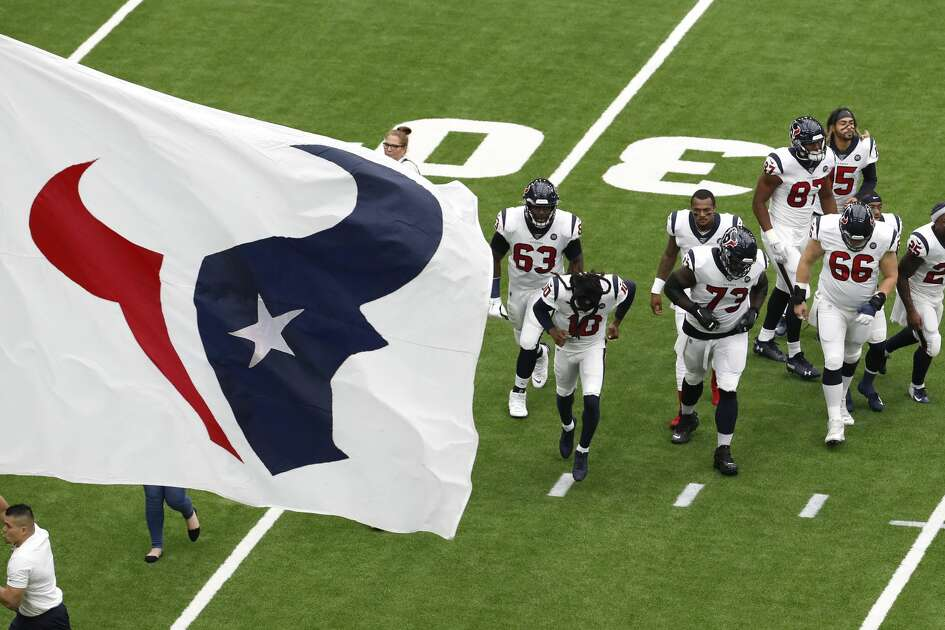 Houston Texans players run onto the field as they are introduced before an NFL football game against the Jacksonville Jaguars at NRG Stadium on Sunday, Sept. 15, 2019, in Houston.