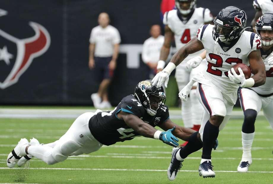 Houston Texans running back Carlos Hyde (23) runs past Jacksonville Jaguars middle linebacker Myles Jack (44) during an NFL football game at NRG Stadium on Sunday, Sept. 15, 2019, in Houston. Photo: Brett Coomer/Staff Photographer