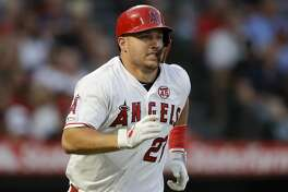 Los Angeles Angels' Mike Trout runs to first after a RBI-single against the Boston Red Sox during the second inning of a baseball game in Anaheim, Calif., Saturday, Aug. 31, 2019. (AP Photo/Chris Carlson)