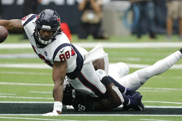 Houston Texans tight end Jordan Akins (88) reaches out for the first down as he is brought down by Jacksonville Jaguars defensive back Ronnie Harrison (36) during an NFL football game at NRG Stadium on Sunday, Sept. 15, 2019, in Houston.
