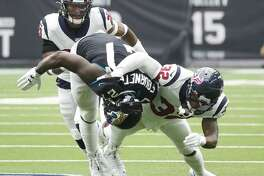 Jacksonville Jaguars running back Leonard Fournette (27) is brought down by Houston Texans cornerback Lonnie Johnson (32) during the second half of an NFL game at NRG Stadium, Sunday, Sept. 15, 2019, in Houston.
