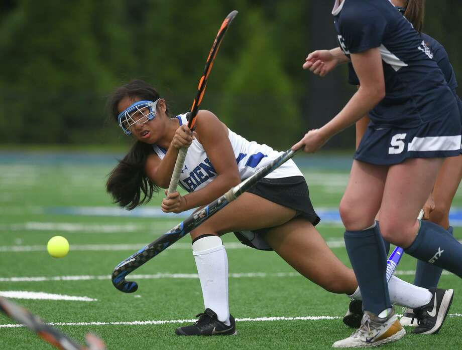 Darien's Tala Garcia sends the ball up the field during a field hockey game at DHS on Sept. 7, 2018. Photo: Dave Stewart / Hearst Connecticut Media / Hearst Connecticut Media