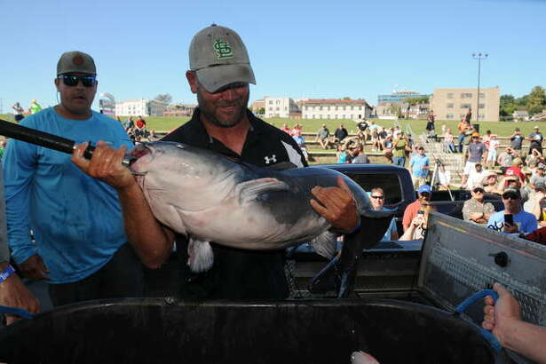 Ryan Casey of Arnold, Missouri, displays his 40-plus-pound catfish Saturday. He and his teammates and his teammates Jason Jackson and Frank Kastl had a three-fish catch weighing 91.42 pounds.