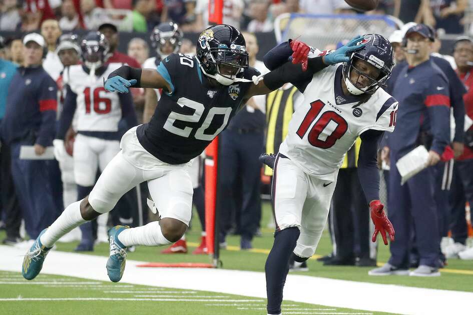 Jacksonville Jaguars cornerback Jalen Ramsey (20) breaks up a pass intended for Houston Texans wide receiver DeAndre Hopkins (10) during the first half of an NFL game at NRG Stadium, Sunday, Sept. 15, 2019, in Houston.