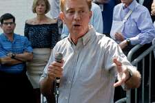Connecticut Governor Ned Lamont addresses the gathering at the Greenwich Democratic Town Committee's annual picnic at the Greenwich Botanical Center, Sunday, Sept. 15, 2019