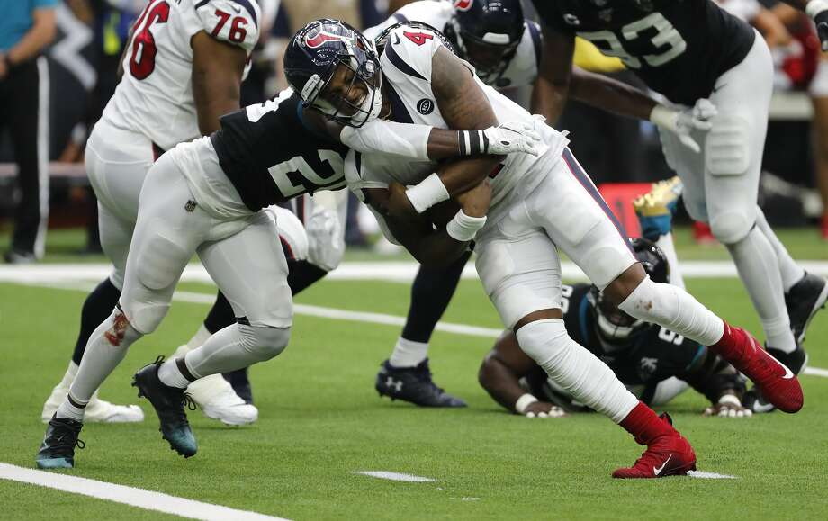 Houston Texans quarterback Deshaun Watson (4) is hit by Jacksonville Jaguars defensive back D.J. Hayden (25) as he runs to the goal line for a 2-yard touchdown during an NFL football game at NRG Stadium on Sunday, Sept. 15, 2019, in Houston. Photo: Brett Coomer/Staff Photographer