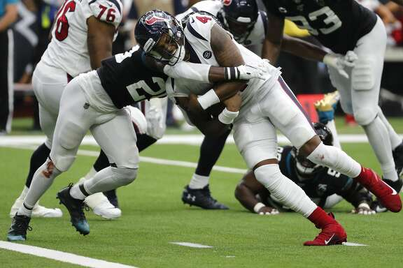 Houston Texans quarterback Deshaun Watson (4) is hit by Jacksonville Jaguars defensive back D.J. Hayden (25) as he runs to the goal line for a 2-yard touchdown during an NFL football game at NRG Stadium on Sunday, Sept. 15, 2019, in Houston.