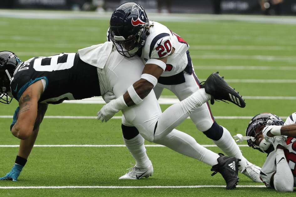 Houston Texans strong safety Justin Reid (20) stops Jacksonville Jaguars tight end James O'Shaughnessy (80) during an NFL football game at NRG Stadium on Sunday, Sept. 15, 2019, in Houston.