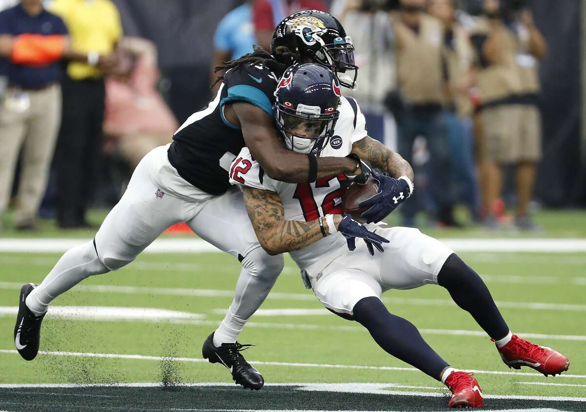 Houston Texans wide receiver Kenny Stills (12) is hit by Jacksonville Jaguars cornerback Tre Herndon (37) as he makes a catch during an NFL football game at NRG Stadium on Sunday, Sept. 15, 2019, in Houston.