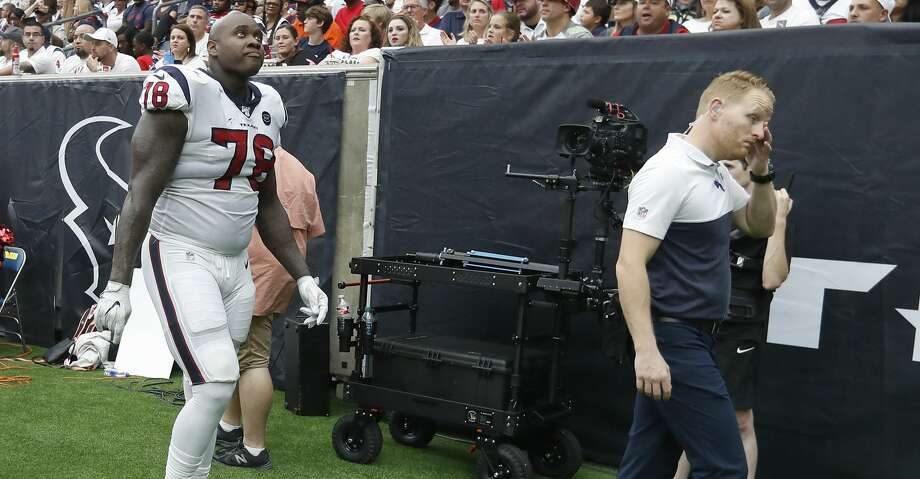 Houston Texans offensive tackle Laremy Tunsil (78) walks back to the locker room with trainers during the second half of an NFL game at NRG Stadium, Sunday, Sept. 15, 2019, in Houston. Photo: Karen Warren/Staff Photographer