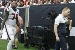 Houston Texans offensive tackle Laremy Tunsil (78) walks back to the locker room with trainers during the second half of an NFL game at NRG Stadium, Sunday, Sept. 15, 2019, in Houston.