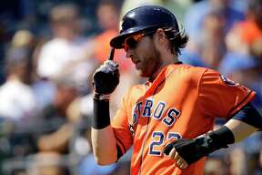 Houston Astros' Josh Reddick celebrates as he scores on a two-run double by Abraham Toro during the third inning of a baseball game against the Kansas City Royals Sunday, Sept. 15, 2019, in Kansas City, Mo.