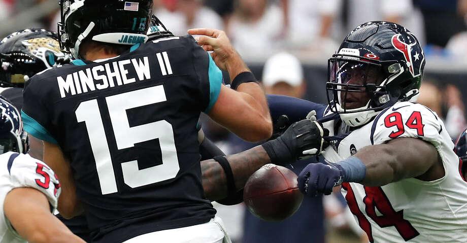 Houston Texans defensive end Charles Omenihu (94) knocks the ball away from Jacksonville Jaguars quarterback Gardner Minshew (15) during an NFL football game at NRG Stadium on Sunday, Sept. 15, 2019, in Houston. Photo: Brett Coomer/Staff Photographer / © 2019 Houston Chronicle