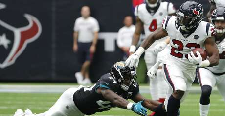 Houston Texans running back Carlos Hyde (23) runs past Jacksonville Jaguars middle linebacker Myles Jack (44) during an NFL football game at NRG Stadium on Sunday, Sept. 15, 2019, in Houston.