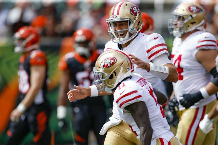 San Francisco 49ers quarterback Jimmy Garoppolo, above, celebrates after wide receiver Marquise Goodwin, below, scores a touchdown during the first half an NFL football game against the Cincinnati Bengals, Sunday, Sept. 15, 2019, in Cincinnati. (AP Photo/Gary Landers)