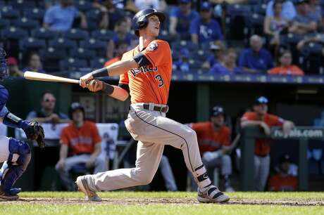 Houston Astros' Kyle Tucker hits a two-run home run during the eighth inning of a baseball game against the Kansas City Royals Sunday, Sept. 15, 2019, in Kansas City, Mo. (AP Photo/Charlie Riedel)